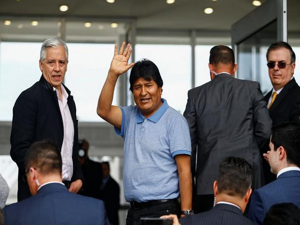 Bolivia's former president Evo Morales waves after arrival in Mexico