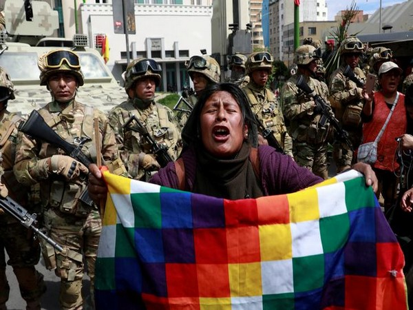 A demonstrator reacts in front of the security forces during clashes with the supporters of former Bolivian President Evo Morales in La Paz
