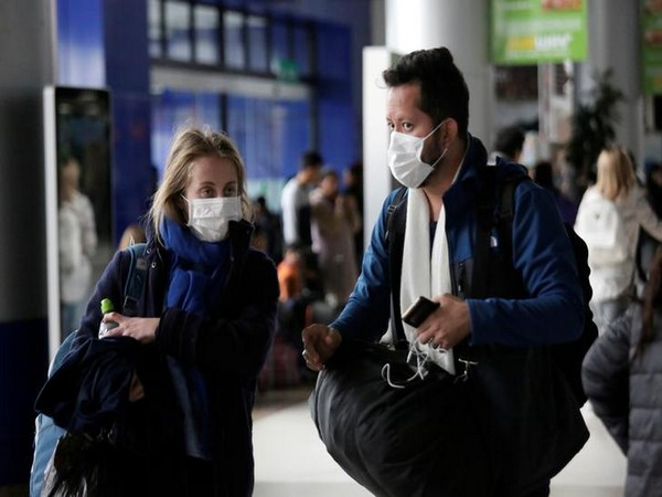 Passengers wear masks, during measures to curb to a coronavirus, at El Alto International Airport in the outskirts of La Paz