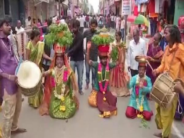 People celebrating Bonalu festival in Telangana on Sunday. Photo/ANI