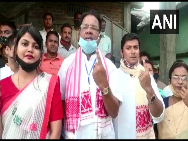 Assam Congress Chief Ripun Bora, along with his family, casts his vote at a polling booth in Gohpur. (Photo/ ANI)