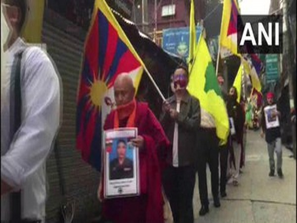 Members of the Tibetan community participating in a candlelight vigil in McLeod Ganj. [Photo/ANI]