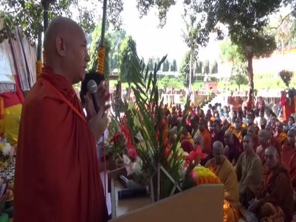 Buddhist monks offering prayers in Bodh Gaya, Bihar on Monday. Photo/ANI