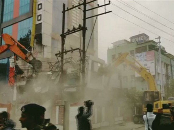 My Home dance bar located in Geetabhavan being demolished on Thursday morning. (Photo/ANI)