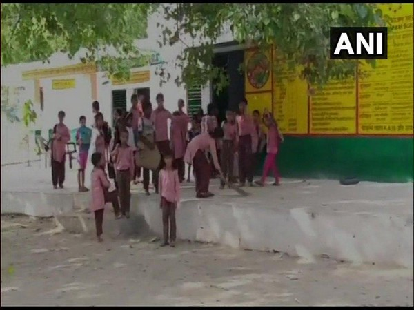 Student of a govt primary school in Bulandshahr seen sweeping the floor of the school.