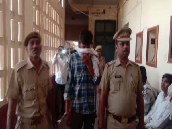 Police personnel with the accused Jaideep in Bulandshahr, Uttar Pradesh on Saturday. Photo/ANI