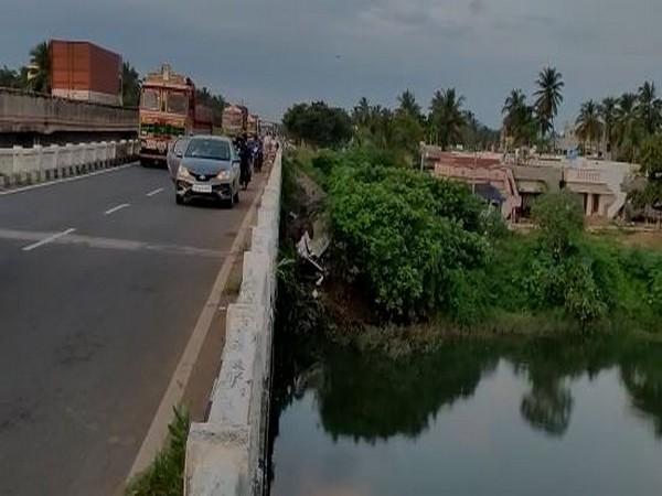 Visual of the bus which fell off the bridge Varaha river alongside National Highway 16 in Andhra Pradesh. (Photo/ANI)