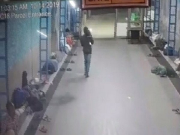 CCTV footage showing an unknown person picking up the girl from the station premises. Photo/ANI