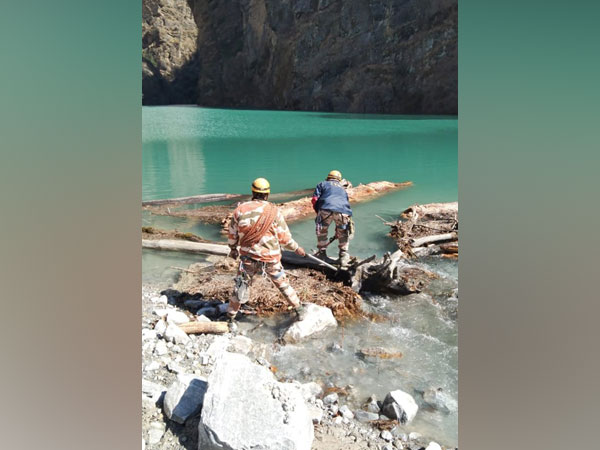 ITBP officials near the lake formed in Chamoli (Photo/ANI)