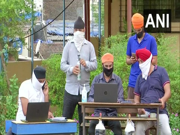 Call center for free medical oxygen cyniders lunched by two Sikh youth organisations in Mumbai. (Photo/ ANI)