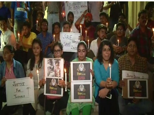 A candle light march was organised in Lucknow on Friday, seeking prompt justice for Twinkle Sharma. Photo/ANI