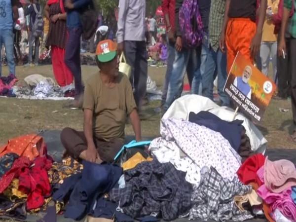 A vendor selling shirts at Brigade ground in Kolkata (Photo/ANI)