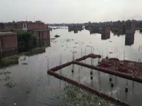 Low-lying areas near Triveni Sangam in Prayagraj, Uttar Pradesh have been flooded due to rise in Ganga River and Yamuna River water level. (Photo/ANI)