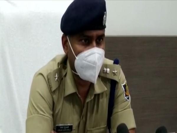 Koraput Superintendent of Police V Guntualli addressing the media