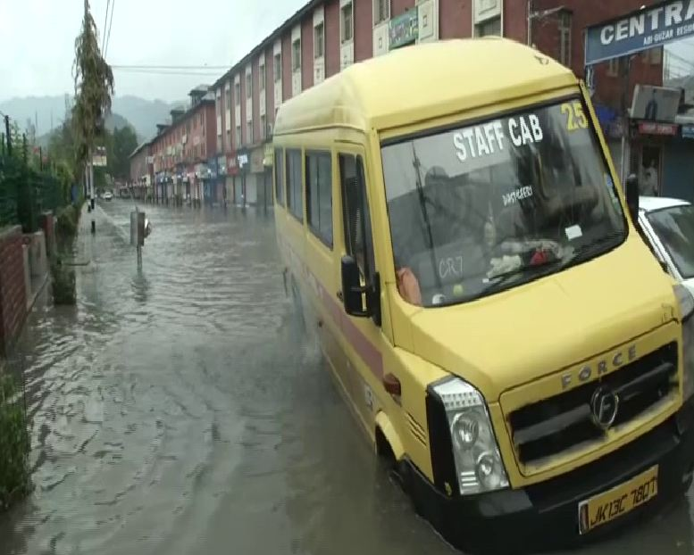 Vehicles broke down due to massive water-logging following heavy downpour in Srinagar, Jammu and Kashmir on Thursday morning (Photo/ANI)