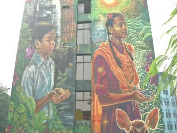 A mural painting showing a young boy and a young girl holding a sapling and a sparrow (goraiya) in their palms (Photo/ANI)