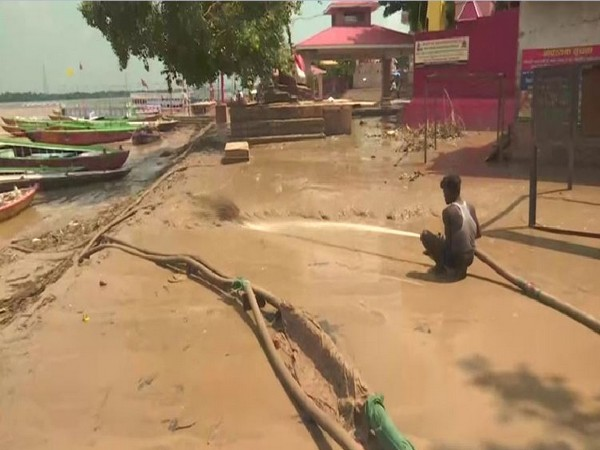 The accumulated mud being removed from a 'ghat' in Varanasi on Monday. Photo/ANI
