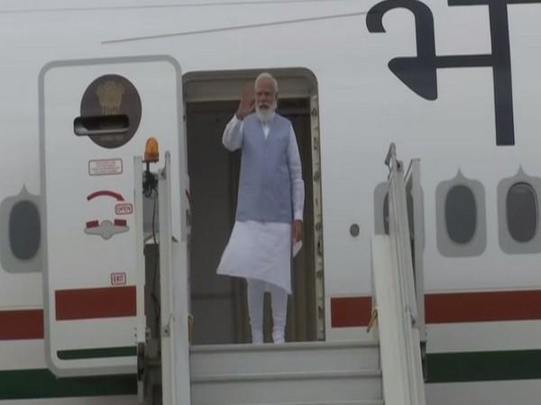 Prime Minister Narendra Modi arrives in New Delhi on Sunday. (Photo/ANI)