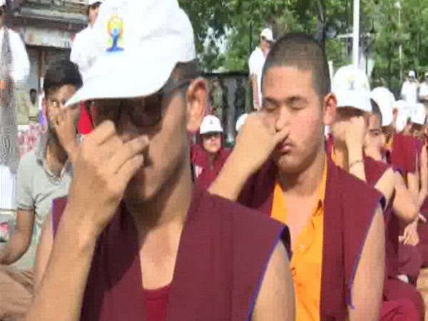Buddhist monks perform yoga on the occasion of 5th International Yoga Day