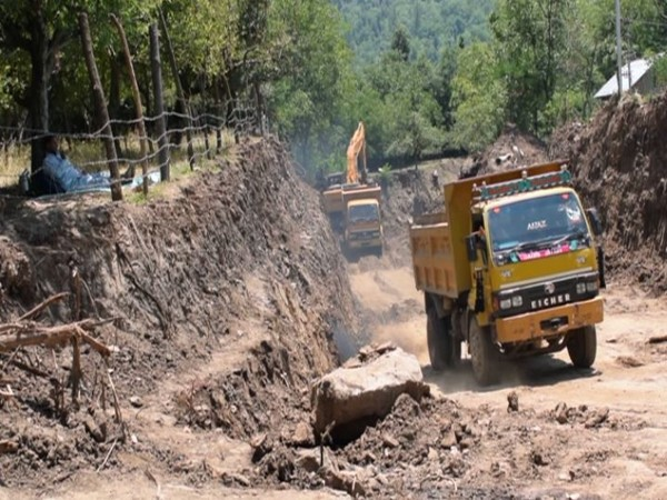 construction work for Tral Lift Irrigation Scheme underway in Pulwama district's Tral (Photo/ANI)