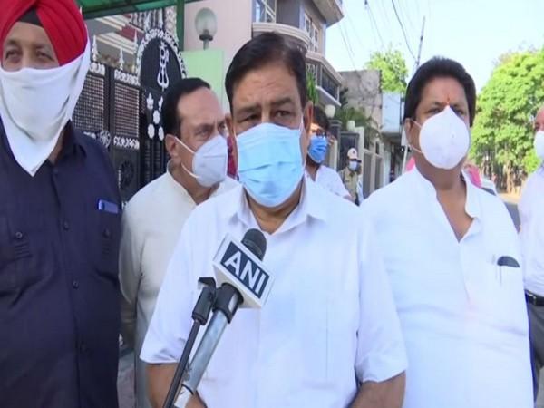 Congress leader Ravinder Sharma speaking to ANI