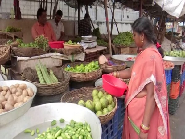 A resident buying vegetables in a market in Hyderabad, Telangana on Thursday. (Photo/ANI)