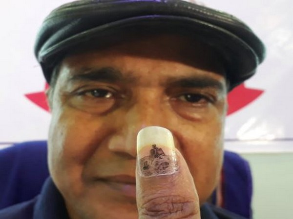 A micro artist from Siliguri, West Bengal, Ramesh Shah draws a miniature painting of Chandrayaan-'s landing on moon, on his thumb nail. (Photo/ANI)