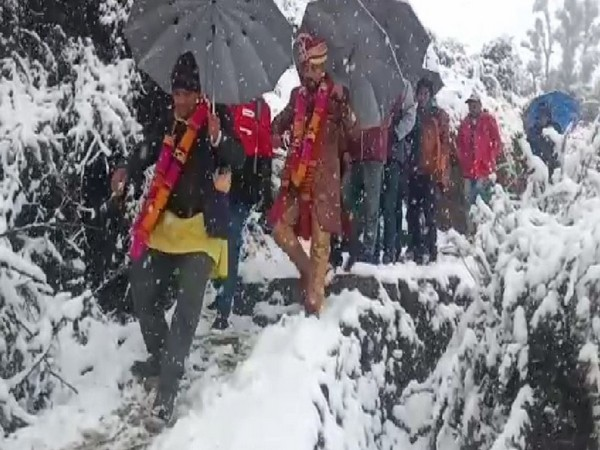 Groom walked for four kilometers on foot to reach the bride's home in Bijra village in Chamoli (Photo/ANI)
