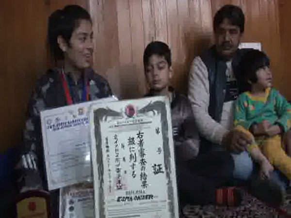 Esra Binti Qaiser with her two siblings and father in Srinagar on Saturday. Photo/ANI
