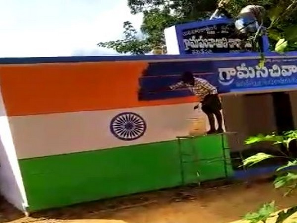 YSRCP government replaced the tricolour painted on a wall of a government building with party colours in Anantapuram. Photo/ANI
