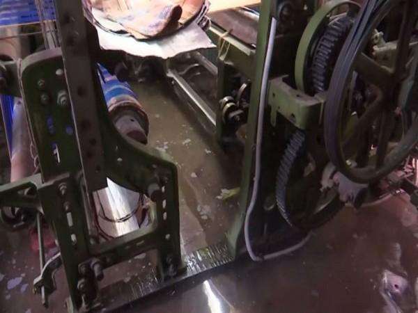 Handloom machines submerged in water in Varanasi on Saturday. Photo/ANI
