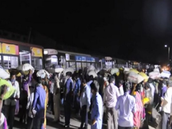 The migrant labourers were brought to Rayanapadu railway station in buses. Photo/ANI