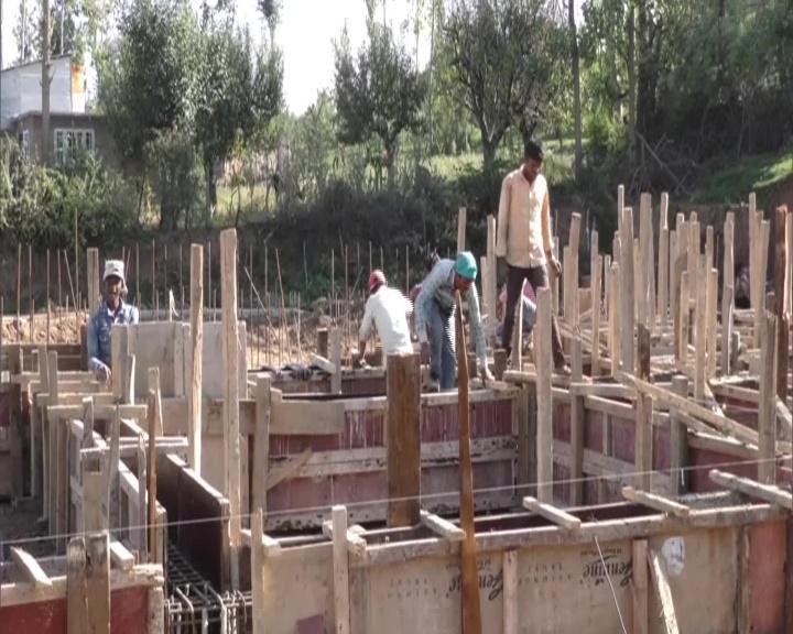 Construction of the indoor stadium in Kupwara district's Handwara is underway. (Photo/ANI)