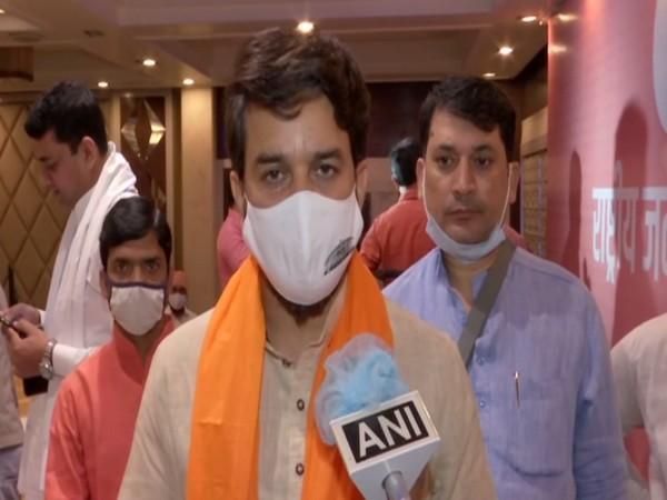 Union Minister Anurag Thakur speaking to ANI (Photo/ANI)