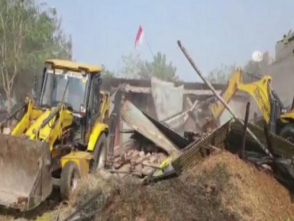 Visual of authorities demolishing encroachments in Super Corridor area of Indore. (Photo/ANI)