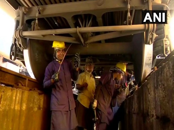 An all-women team looking after the maintenance of a train at Thiruvananthapuram Central Railway Station (Photo/ANI)
