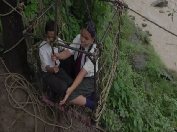 School students risk their lives by travelling in makeshift trolley to cross the river during monsoon in Nainital's Danijela village (Photo/ANI)