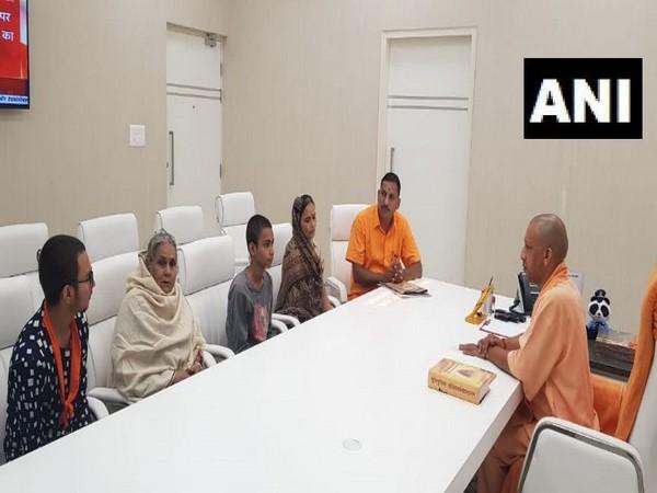 Family members of Kamlesh Tiwari met Chief Minister Yogi Adityanath at his residence in Lucknow on Sunday (Photo/ANI)