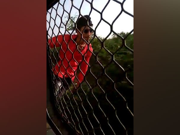 A visual of the video while Dilshan was attempting stunts on a local train (Photo/ANI)