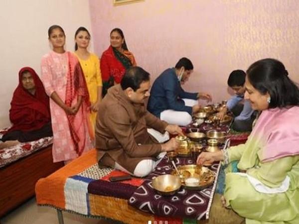 Gautam Adani having a meal at Deval Ben Gadhvi's home on Bestu Varash (Photo/Twitter/Gautam Adani)