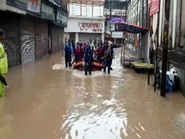 The National Disaster Response Force (NDRF) troops rescue residents from the flood affected areas in Nashik on Sunday. (Photo/ANI)