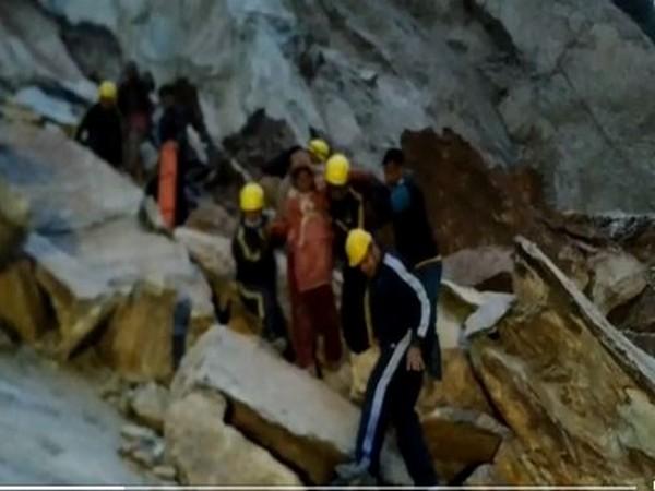SDRF helping pregnant woman cross blocked Gangotri National Highway (Photo/ANI)