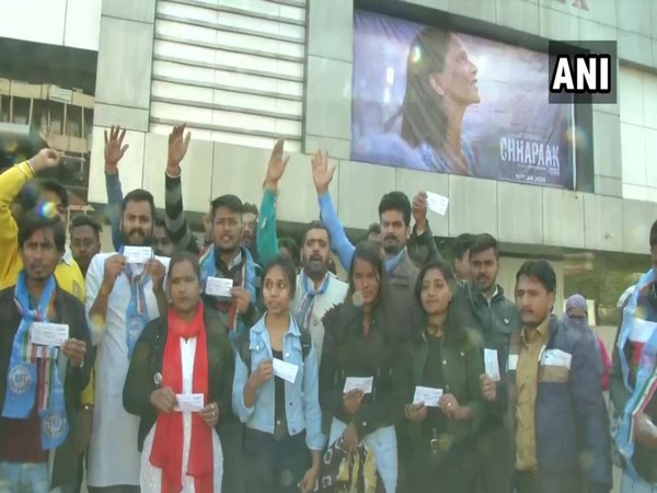 National Students' Union of India (NSUI) workers distributing free tickets to Chhapaak movie in Bhopal on Friday (Photo/ANI)