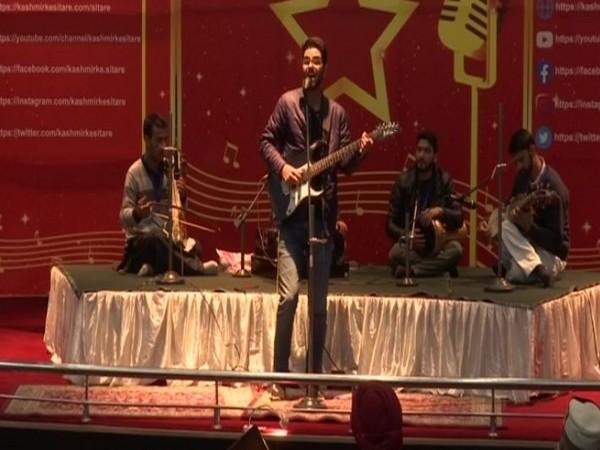 Kashmiri artists performing at the event organised by JKLI in Srinagar on Saturday. (Photo/ANI)