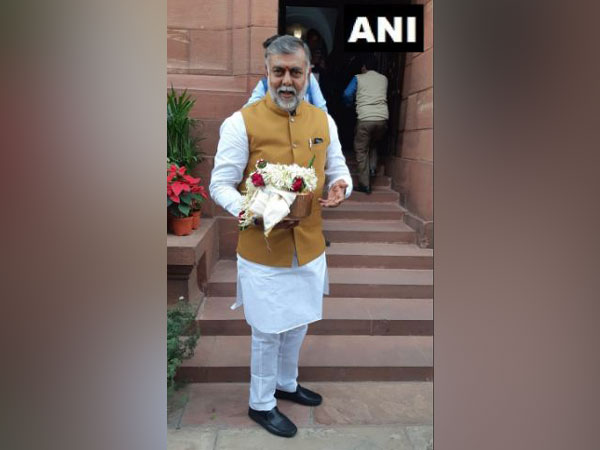 Union Minister Prahlad Singh Patel arrives at the parliament with an urn containing soil of Jallianwala Bagh on Thursday. Photo/ANI