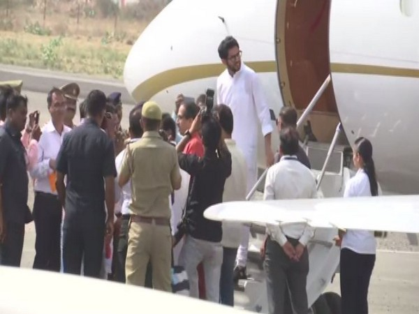 Uddhav Thackeray and his son Aditya Thackeray being welcomed at the airport on Sunday. (Photo/ANI)