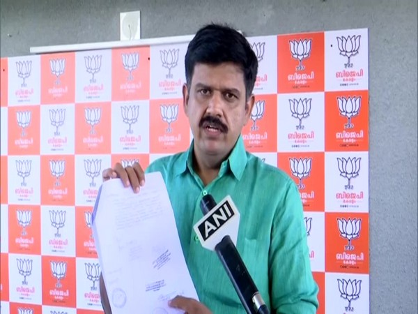 BJP leader Sandeep Warrier with the 'forged' documents, in convresation with ANI. (Photo/ANI)