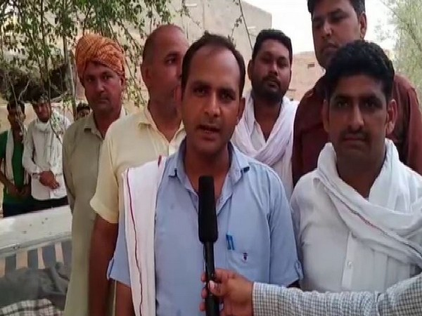 Villagers stage a protest against the state government and demanded to waive off farmers loans (Photo/ANI)