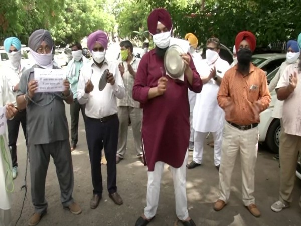 Transporters staging protest against hike in fuel prices in Delhi (Photo/ANI)