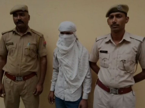 Rajasthan Police with the accused in Alwar on Thursday. Photo/ANI